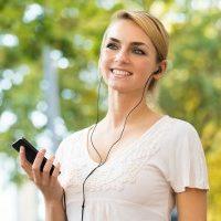 bigstock-Woman-Listening-To-Music-Throu-108009698